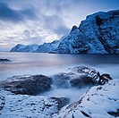 Dramatic scenery at snow covered coastline, &#197; I Lofoten, Lofoten Islands, Norway