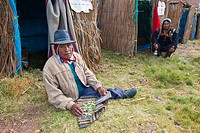 Peru, Cuzco province, Huasao, listed as mystic touristic village, shaman curandero paraplegic in front of his hut of reeds