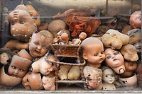 Italy, Lazio, Rome, heads of dolls behind a shop window