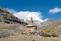 Tibetan Buddhism, ancient Stupa, snow-capped sacred Mount Kailash, Gang Rinpoche, south side with channel, pilgrim road at the monastery Gompa, Kora, ...