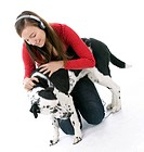 Adult girl in headphones relaxing with her lovely dog