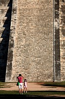 A woman taking photo for a young girl in front of the staircases of El Castillo aka Kukulkan Pyramid  Chichen Itza  Mexico