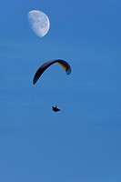 Paraglider with moon