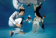 Bride and groom, underwater wedding in a pool