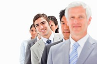 Close_up of a single line of smiling business people with focus on the third person