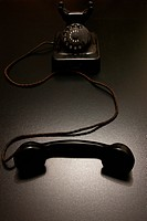 an old vintage telephone in dramatic lighting.
