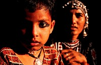 Hindu girl and woman traditionally dressed in Rajasthan, India. They belong to an untouchable group whose men are snake charmers and musicians, and wo...