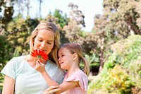 Mother looking at a flower her daughter is holding