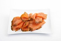 Gravlax, salmon, smoked slices with dill on white porcelain plate
