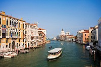 The Grand Canal with typical Venetian architecture and a waterbus or ´vaporetto´. Venice, Italy.
