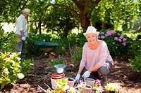 Woman gardening flowers