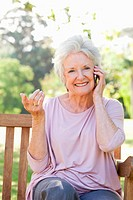 Woman smiling while making a call and performing a hand gesture