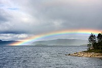 Rainbow over Saedvajaure lake, Norrbotten County, Sweden, Scandinavia, Europe