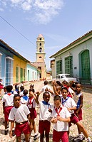 School children playing in a street in the old colonial city of Trinidad, Cuba.