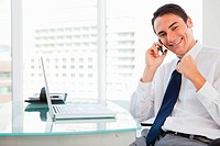 Happy businessman receiving good news by phone