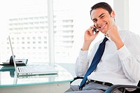 Portrait of a businessman receiving good news by phone
