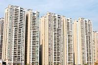 Modern apartment blocks against blue sky