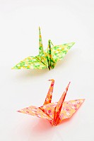 origami cranes on a white background