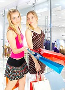 Two girls with bags _ comparison shopping. Sale!