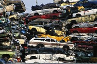 Crushed automobiles that will eventually be shredded into scrap metal.