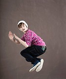 Boy leaping into the air