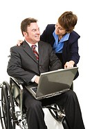 Disabled businessman uses a laptop computer with the help of a colleague. Isolated on white.
