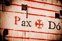 Detail of a 17th century old Latin missal and book of hymns, on the word ´Pax´ peace.