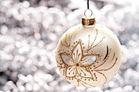 Closeup image of a golden Christmas toy