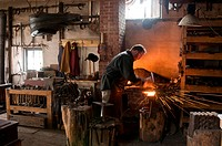 Blacksmith at work.