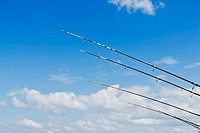 Fishing rods against blue sky