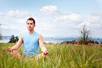 A shot of a mixed race man practicing yoga outdoor