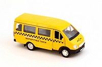 Toy cars. Yellow bus taxi.