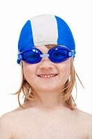 boy with long blond hair in with swimming goggles and cap - isolated on white