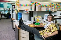 Full length businessman in Hawaiian decorated office