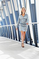 Smiling businesswoman on walkway