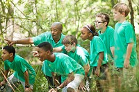 Students exploring forest with teacher