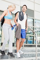 Couple walking on gym steps together