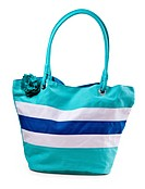 turquoise striped beach bag isolated on a white background