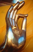 Brass Buddha hand with gold leaf applied to palm, Vitarka mudra intellectual argument, wheel of law, Thailand