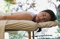 Hispanic woman lying on a massage table