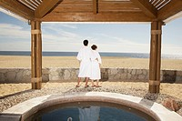Couple in bathrobes outdoors at beach resort