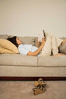 Woman reading on sofa