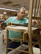 Amana, Iowa - A worker makes furniture at the Amana Furniture & Clock Shop   The shop is one of the enterprises started when German immigrants establi...