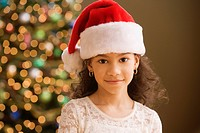 Hispanic girl wearing santa hat