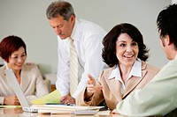 Businesspeople working at conference table