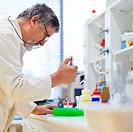 senior male researcher carrying out scientific research in a lab shallow DOF, color toned image