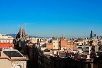The Temple of La Sagrada Familia and other buildings and skyscrapers of Barcelona.Photo background.