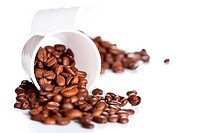 coffee beans in a cups on white background