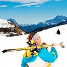 A picture of a young female skier enjoying snow in the Alpes