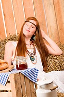 Young redhead hippie woman organic breakfast in country style